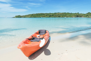 Summer, Travel, Vacation and Holiday concept - Orange kayaks on