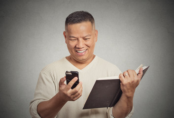happy middle aged man reading funny news on smart phone