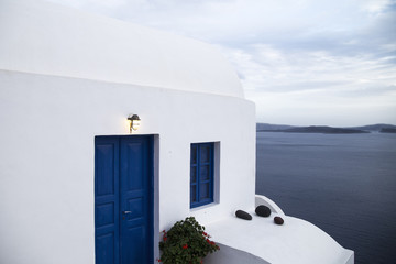 Panoramic view from traditional cave house in Santorini Greece