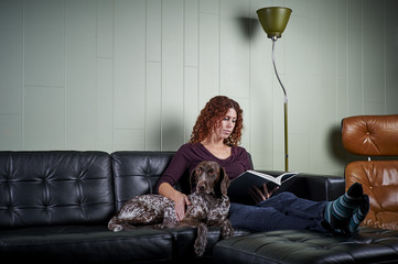woman reading with her dog