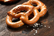 Fresh pretzels with sea salt close-up on  dark board background - 80432095