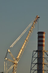 Power plant. Crane at a construction site. Chimney and smoke