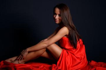 Brunette woman posing in studio