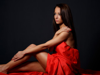 Brunette woman posing in studio
