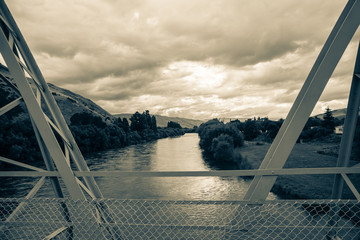 Clutha river, overcast sky old faded photo effect