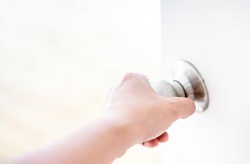 Hand opening door knob-white door