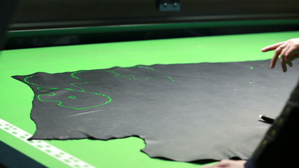 Placing patterns on leather section with laser