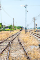 Vacant Rail way switch track with yellow die grass