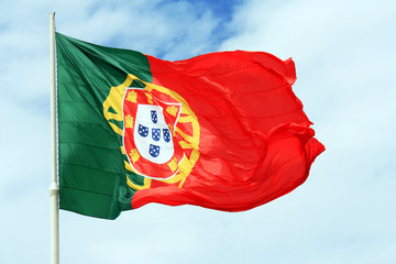 Flag of Portugal against the blue sky