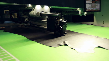 Automated production of footwear. Cutting leather