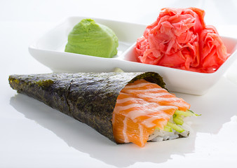 Temaki with ginger and wasabi over white background