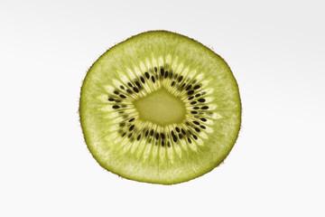 Slice of Kiwi on white gradient background.
