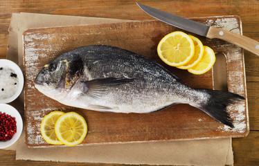 Fresh raw fish on a  cutting board