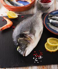Fresh fish  with  spices and shrimps - healthy food.