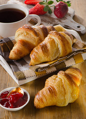 Fresh croissants with jam and berries for breakfast