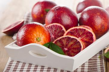 Fresh blood oranges in  white wooden box
