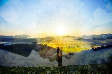 Double exposure handshake on a forest background