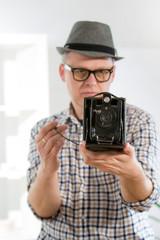 Man with retro film camera
