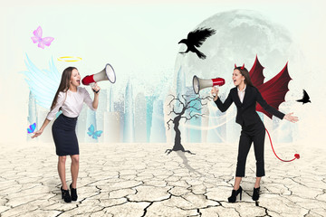 Portrait of angel and devil girls with megaphone