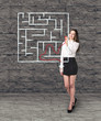 Beautiful businesswoman showing something in maze