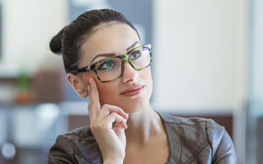 Beautiful woman with spectacles looking