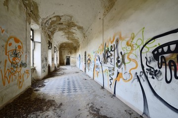 old abandoned corridor with graffiti.