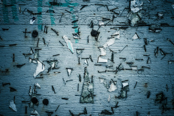 Background texture of weathered and grungy noticeboard