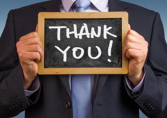 thank you handwritten on blackboard