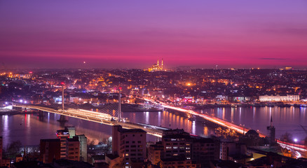 Golden horn at night with mosque skyline in pink