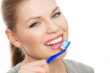 Close-up of beautiful dental care woman wit toothbrush
