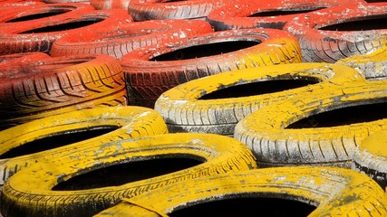 Colorful stack of tyres