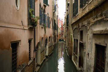 A view from above of a quiet backwater, a narrow canal with historic buildings rising from the water.