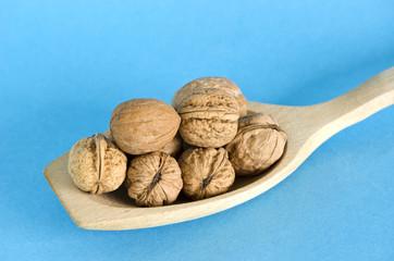 walnuts in wooden spoon