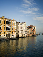 Tall palazzos and historic buildings lining the Grand Canal in Venice.