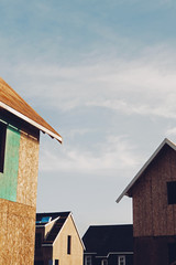Homes under construction in suburban housing development