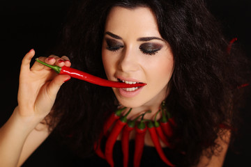 Sexy naked brunette girl with red cayennes peppers