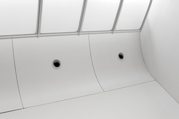 Ceiling with air conditioning / ventilation duct fittings