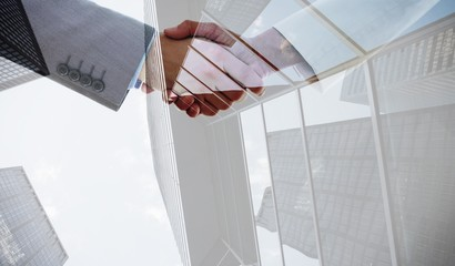 Composite image of shaking hands after business meeting