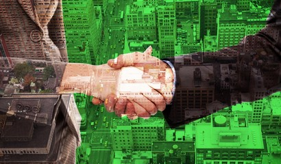 Two business people shaking their hands