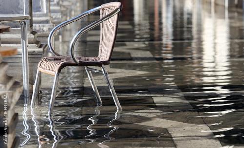Leinwanddruck Bild chair during the flood in Venice