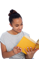 Smiling Young Woman Reading a Yellow Book