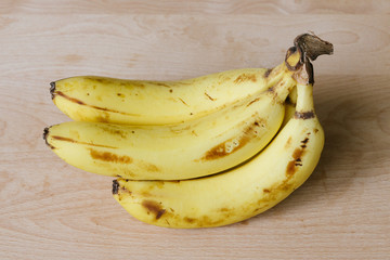 a bunch of bananas on wooden background