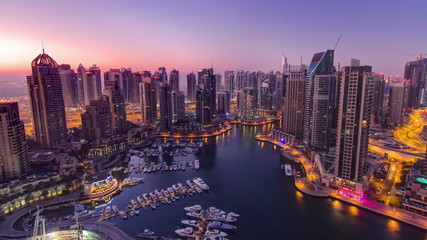 Dubai marina harbor panorama from night to day transition