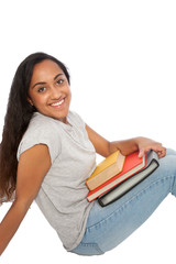 Happy Indian Girl with Books Sitting on the Floor