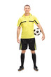 Football referee in a yellow jersey holding a ball
