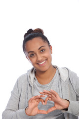 Smiling Young Woman Showing Heart Shaped Fingers