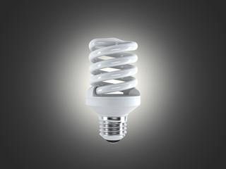 Energy saving fluorescent lightbulb on a dark bakground