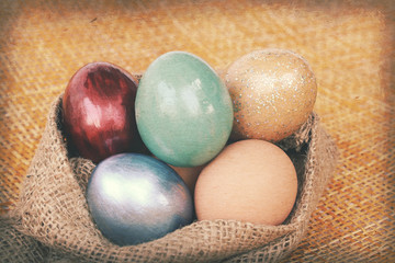 Vintage paper textures, Colorful easter eggs in burlap hessian s