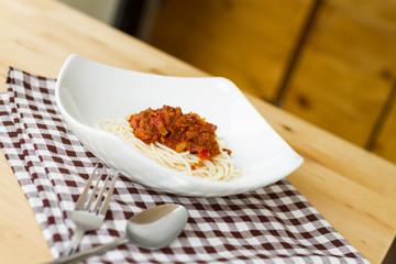spaghetti bolognese on white dish