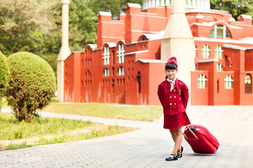 A young girl dressed as a flight attendant sees the sights